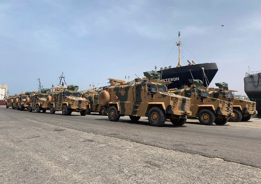 "A photo posted on the Facebook Page of the media bureau of ""Volcano of Anger"" operation on May 18, 2019, reportedly shows Turkish-made armoured personnel vehicles, shipped to Libya's internationally recognised Government of National Accord (GNA), arriving at Tripoli port. GNA forces are currently battling fighters from commander Khalifa Haftar's self-styled Libyan National Army, which launched an offensive on April 4 to take the capital. The GNA said the new weaponry had been supplied ""in preparation for a vast operation to annihilate the rebels of the war criminal, the rebel Haftar."" Media Bureau of ""Volcano of Anger"" operation / AFP"