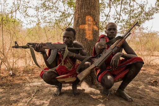 Armed Dinka cattleguards in South Sudan in 2018. Photo via AFP.