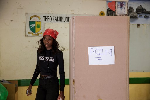 A Namibian woman exits a voting booth after electronically marking her vote during the Namibian Presidential and parliamentary elections, on November 27, 2019 in Windhoek. GIANLUIGI GUERCIA / AFP