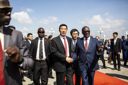 Special Envoy of the People Republic of China, Wang Yong (C) and Cabinet Secretary for Transport, Infrastructure, Housing, Urband Development and Public Works, James Macharia(R), arrives at the Nairobi Terminus during the commissioning of the Standard Gauge Railway (SGR) Freight Operations to the Naivasha Inland Container Depot in Nairobi, on December 17, 2019.