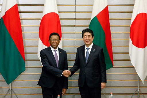 Madagascar's President Hery Rajaonarimampianina (L) shakes hands with Japan's Prime Minister Shinzo Abe at the start of talks at the latter's official residence in Tokyo on December 5, 2017