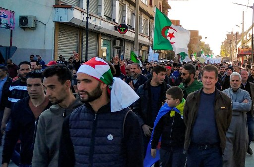 "Algerians march in an anti-government demonstration in the Algerian city of Bordj Bou Arreridj, about 240kms east of the capital Algiers, on February 14, 2020. Even though the start of the ""Hirak"" in Algeria began on February 22, 2019, the first signs of the popular ""movement"" of protest in Algeria began to appear several days earlier, particularly in Bordj Bou Arreridj, often recognised as the ""capital of Hirak""."