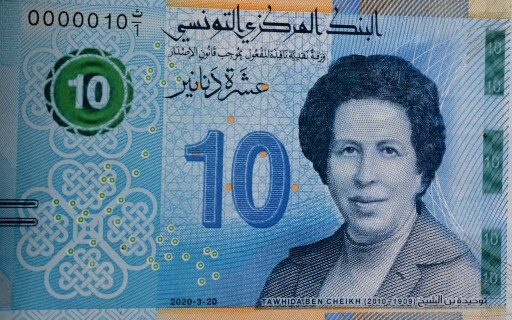 A new Tunisian bank note circulating in the country is pictured inside a bank in the capital Tunis on March 27, 2020. The Central Bank of Tunisia (BCT) today put new 10 Dinar (around 3 euros) bank notes into circulation, illustrated for the first time by the portrait of a woman: Tawhida Ben Cheikh, the first female doctor of the Maghreb region of North Africa.  FETHI BELAID / AFP