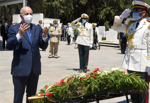Algerian president Abdelmadjid Tebboune prays during a ceremony in Algiers on July 5, 2020, to lay to rest the remains of twenty-four resistance fighters returned from Paris after more than a century-and-a-half, on the fifty-eighth anniversary of Algeria's independence from France. The skulls of the fighters, who were shot and decapitated in the early years of the French occupation, were on display at the Palace of Culture before they were interred in coffins draped with the national flag in El-Alia Cemetery's Martyrs' Square. (Via Algerian Presidency Press Office/AFP)