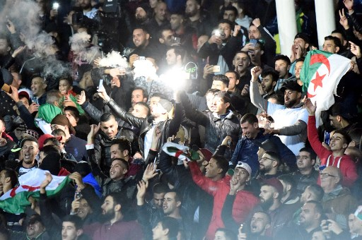 Algeria's supporters cheer during the 2021 Africa Cup of Nations group H qualifying football match between Algeria and Zambia at the Mustapha Tchaker stadium in the city of Blida on November 14, 2019.