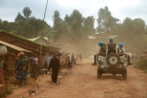 In this photograph taken on March 13, 2020, Moroccan soldiers from the UN mission in DRC (Monusco) ride in a vehicle as they patrol in the violence-torn Djugu territory, Ituri province, eastern DRCongo. Fresh violences have been registered against civilians in this territory where more than 700 hundreds have been slaughtered since December 2017, leading the UN to denounce a possible crime against humanity. SAMIR TOUNSI / AFP