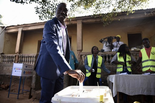 Domingos Simoes Pereira (L), the presidential candidate for the African Party for the Independence of Guinea and Cape Verde (PAICG), casts his ballot at a polling station during the second round of the presidential election in Bissau, on December 29, 2019. Voters in Guinea-Bissau cast their ballots in a presidential runoff on December 29, 2019, with the hope of ending months of political turmoil in the coup-prone West African state that is one of the world's poorest nations. SEYLLOU / AFP