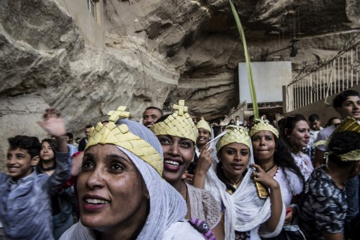 Ethiopian Orthodox and Egyptian Coptic Christians take part in Palm Sunday celebrations at the Saint Simon Church in Egypt