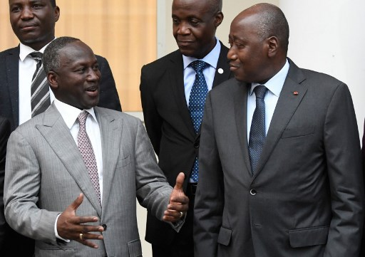 Ivory Coast's Prime Minister, Amadou Gon Coulibaly (R), listens to Adama Bictogo (L), from the Rally of Houphouëtists for Democracy and Peace (RHDP), after a meeting with the country's political leaders and civil society representatives on February 17, 2020