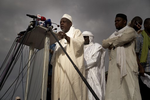 Imam Mahmoud Dicko, one of the most influential personalities in Malian political landscape, addresses the crowd the Independence square in Bamako on June 5, 2020 after he've called for a political march to be held after the Friday prayer, against Malian president Ibrahim Boubacar Keïta and his politics. Tens of thousands of people rallied in Mali's capital Bamako on Friday demanding the departure of President Ibrahim Boubacar Keita, in a show of force from his recently energised opponents.  MICHELE CATTANI / AFP
