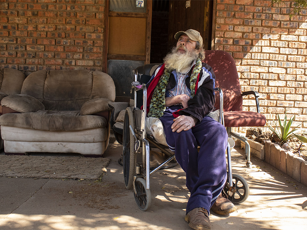Kosmos, Tshwane. Paul used to beg on the street. The people of Kosmos found him and welcomed him in their odd family. ©Manash Das.