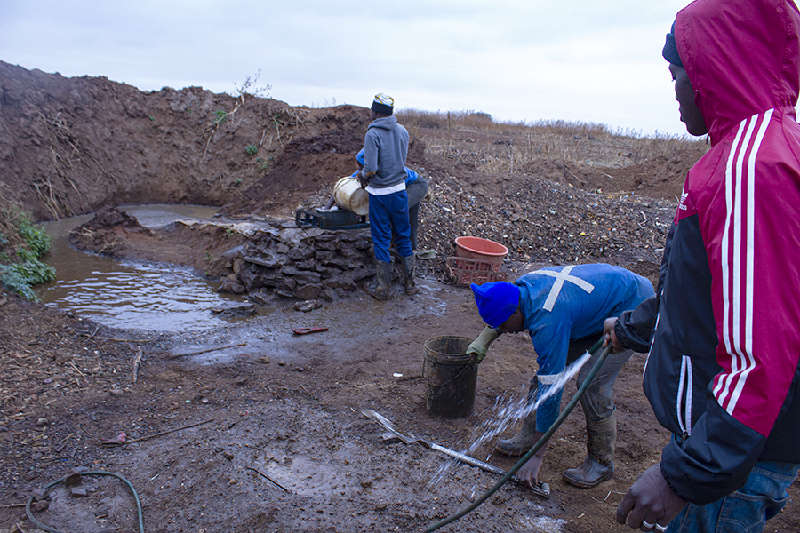 Xawela, Carletonville. Several pit holes are used daily to process the soil. ©Manash Das.