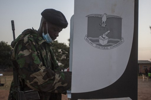 "A soldier votes at a polling booth during the presidential elections at the Malembo polling station in Lilongwe on June 23, 2020. Malawians return to the polls on June 23, 2020 for the second time in just over a year to vote for a new president after Peter Mutharika's re-election was annulled over rigging. The election is much anticipated after the Constitutional Court early this year ruled that the May 2019 vote, won narrowly by Mutharika, was fraught with ""grave and widespread irregularities"" including the use of correction fluid on results sheets.  AMOS GUMULIRA / AFP"