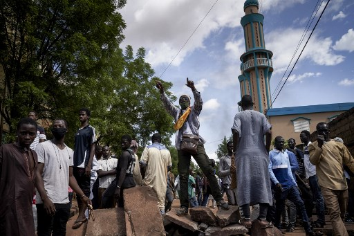In the Badalabougou neighborhood of Bamako, people gather on July 12 at the mosque where Imam Mahmoud Dicko led prayers for the victims who died in clashes between protestors and government forces the previous two days. (Michele Cattani/AFP)