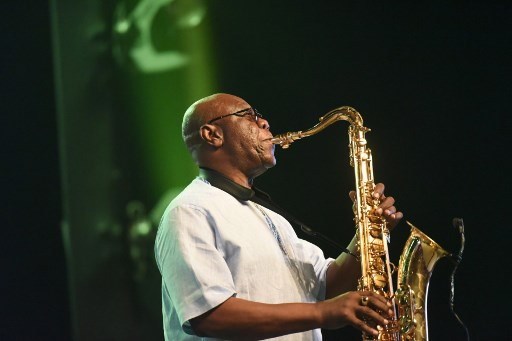 In this file photo taken on June 30, 2018 (FILES) In this file photo taken on June 30, 2018, Emmanuel N'Djoke Dibango, known as Manu Dibango, saxophonist and Franco-Cameroonian singer of world jazz, performs during his concert at the Ivory Hotel Abidjan. Veteran Afro jazz star Manu Dibango died of the COVID-19 (the novel coronavirus) said relatives on March 24, 2020.