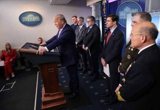 .S. President Donald Trump speaks at the press briefing room flanked by (L-R) U.S. Coast Guard Commandant Admiral Karl Schultz, National Security Advisor Robert O'Brien, Attorney General William Barr, Defense Secretary Mark Esper, Chairman of the Joint Chiefs of Staff Gen. Mark Milley and Chief of Naval Operations Admiral Michael Gilday on April 1, 2020 in Washington, DC. After announcing yesterday that COVID-19 could kill between 100,000 and 240,000 Americans, the Trump administration is also contending with the economic effects of the outbreak as the stock market continues to fall, businesses remain closed, and companies lay off and furlough employees. Win McNamee/Getty Images/AFP WIN MCNAMEE / GETTY IMAGES NORTH AMERICA / Getty Images via AFP