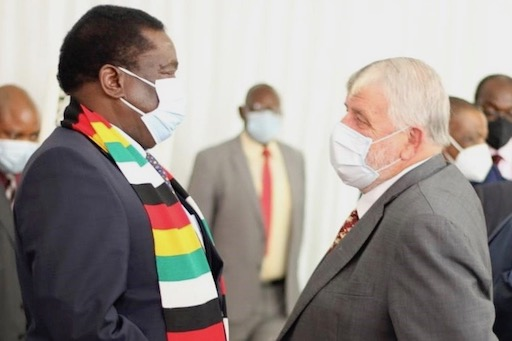 President Emmerson Mnangagwa and a member of the Commercial Farmers' Union of Zimbabwe (Photo via Twitter)