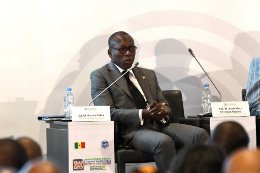 Patrice Talon, the President of Benin during a conference co-organized by the International Monetary Fund (IMF) on sustainable development and debt at the Abdou Diouf de Diamniadio conference centre in Diamniadio, on December 2, 2019.  SEYLLOU / AFP