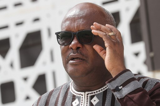 Burkina Faso President Roch Marc Christian Kabore poses for a group picture during the G5 Sahel summit on June 30, 2020, in Nouakchott. The leaders of the G5 Sahel West African countries and their ally France are meeting to confer over their troubled efforts to stem a jihadist offensive unfolding in the region, six months after rebooting their campaign in Pau, southwestern France. Ludovic MARIN / POOL / AFP