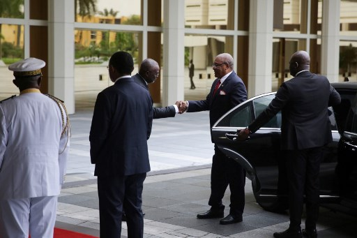 Sao Tome e Principe's president Evaristo do Espirito Santo Carvalho (2R) arrives at the extraordinary summit of the Economic Community of Central African States (ECCAS) in Libreville, on December 18, 2019. The extraordinary summit, announced with only a few weeks' notice, aims at beefing up the 11-nation Economic Community of Central African States (ECCAS) secretariat to create a more powerful commission, similar to that of the AU or European Union. Only four ECCAS heads of state were present -- presidents Idriss Deby Itno of Chad; Faustin-Archange Touadera of the Central African Republic; Felix Tshisekedi of the Democratic Republic of Congo; and Evaristo Carvalho of Sao Tome and Principe. Steeve Jordan / AFP