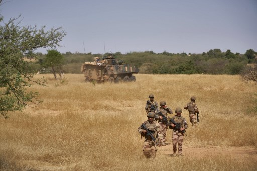 Soldiers of the French Army monitors a rural area during the Barkhane operation in northern Burkina Faso on November 12, 2019.