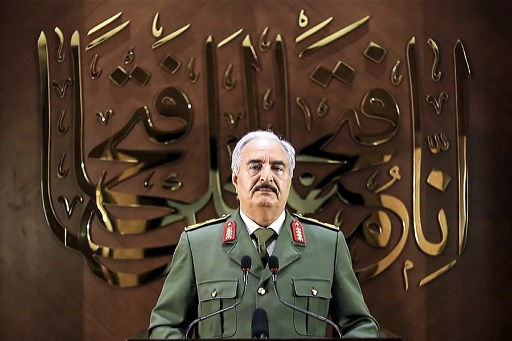 "This image grab taken from a video published by the War Information Division of military strongman Khalifa Haftar's self-proclaimed Libyan National Army (LNA) on April 28, 2020 shows Haftar giving a speech, saying he had ""a popular mandate"" to govern the country, declaring a key 2015 political deal over and vowing to press his assault to seize Tripoli. In a speech on his Libya al-Hadath TV channel, Haftar said his self-styled Libyan ""army"" was ""proud to be mandated with the historic task"" of leading Libya. He did not make clear whether an elected parliament in the country's east, a signatory to the deal, backed his move -- or what its future role would be. Haftar has so far drawn his legitimacy from the administration based in the country's east, and last April his forces launched an assault to seize the capital Tripoli, in the west, from the Government of National Accord. LNA War Information Division / AFP"