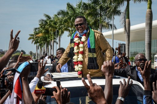 Tundu Lissu, former Tanzanian member of parliament with the Chadema main opposition party, reacts to supporters as he returns after three years in exile to challenge President John Magufuli in elections later this year. (Photo by STR/AFP)