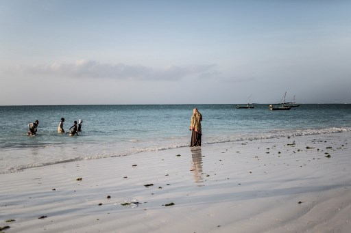 Children play in the sea at Nungwi Beach on the island of Zanzibar. (Gulshan Khan/via AFP)