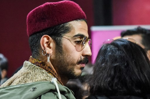Achraf, a 26-year-old Tunisian gay artist, arrives to attend the opening of the second edition of the Mawjoudin Queer Film Festival in the Tunisian capital Tunis on March 22, 2019. Cries of joy and the applause of hundreds of people: the second edition of the Mawjoudin Film Festival, which aims to promote stories of sexual minorities and defend their rights, began on March 22 in a festive atmosphere. Mawjoudin (We are present), a Tunisian association defending the rights of lesbian, gay, bisexual and transgender people (LGBT), organises the festival in the North African country where homosexuality remains illegal. FETHI BELAID / AFP
