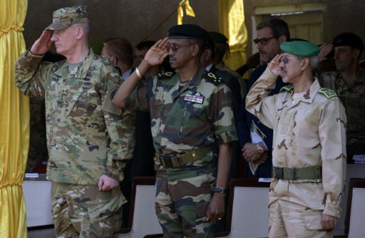 US General David Rodriguez (L), Senegalese Chief of Staff Mamadou Sow (C) and Mauritanian General Hamne O Sidy (R) salute during a military parade as part of the closing ceremony of the three-week joint military exercise between African, US and European troops, known as Flintlock, on February 29, 2016 in Saint Louis.