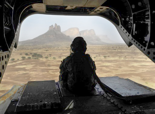 A British soldier leaves the Hombori area aboard a Chinook helicopter on March 28, 2019 during the start of the French Barkhane Force operation in Mali's Gourma region. Troops will begin operating near the Burkina border from a new French military base in east-central Mali. The base will be the newest outpost of Operation Barkhane, France's 4,500-strong anti-jihadist force which is headquartered in Chad but also operates in Burkina Faso, Mali and Niger. Daphné BENOIT / AFP