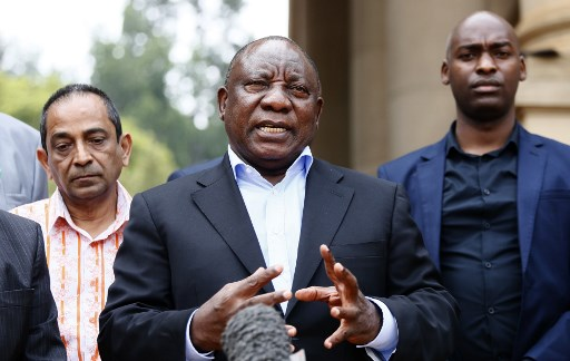 n this file photo taken on March 22, 2020 South African President Cyril Ramaphosa (C) conducts a media briefing at the end of a meeting with various business leaders and political party leaders on matters relating to the COVID-19 outbreak at the Union Buildings in Pretoria. The World Bank and IMF said on April 17, 2020 Africa needs $44 billion more to fight the coronavirus pandemic despite a freeze in debt payments for many countries and massive pledges of support. Phill Magakoe / AFP